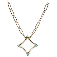Maviada's Color Logo Chain Necklace in 18 Karat Gold, Reverse Cut Sky Blue Topaz