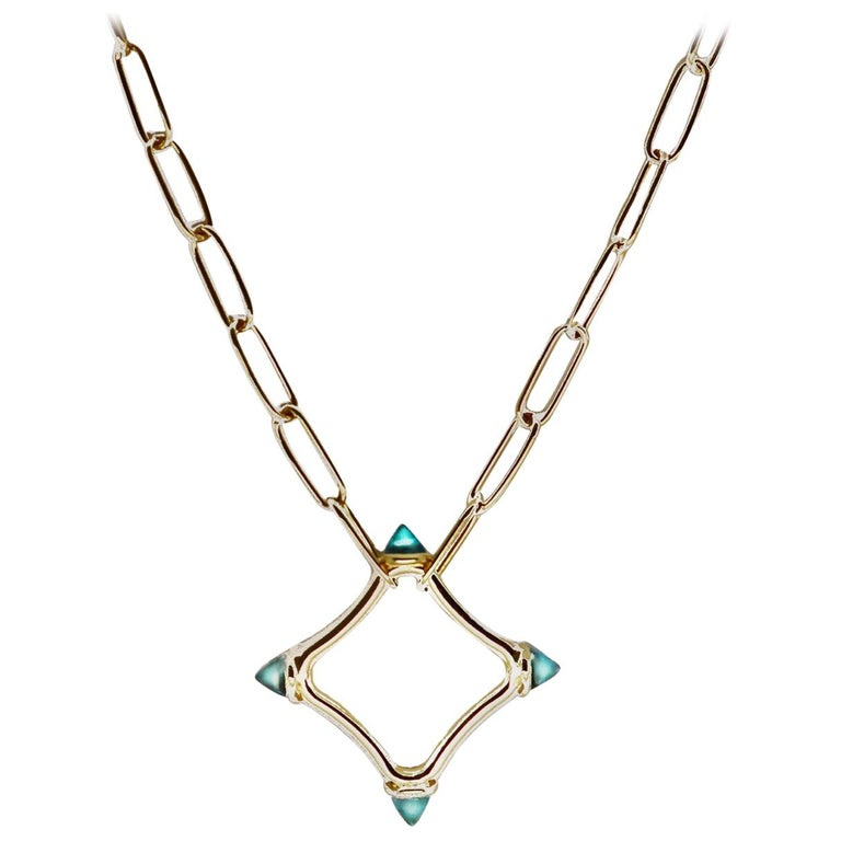 Maviada's Color Logo Chain Necklace in 18 Karat Gold, Reverse Cut Sky Blue Topaz For Sale