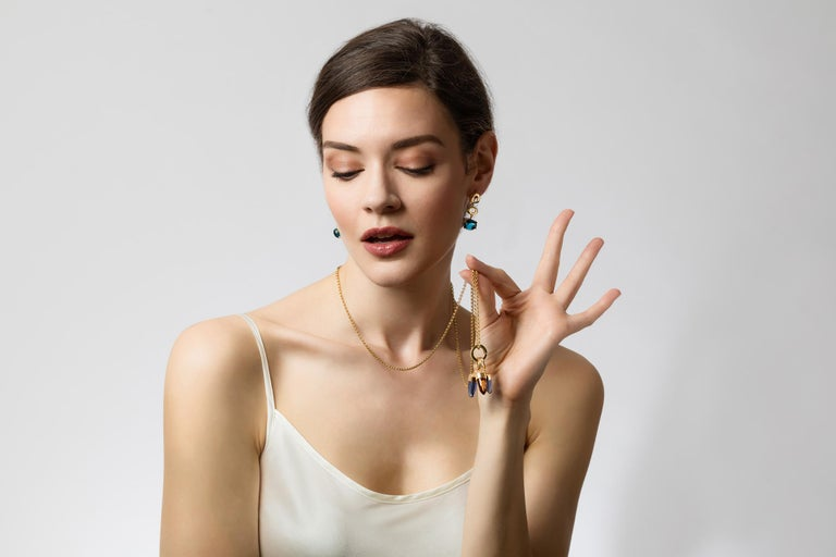 St Tropez 18 karat solid gold drops, 10x12mm cabochon stone The name says it all, charisma all the way. These earrings make you feel St Tropez chic. We recommend wearing them as evening wear, to a spectacular event, or just when you want to feel