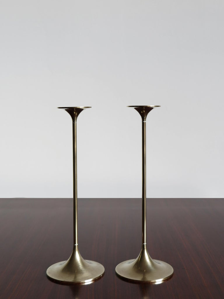 Pair of solid brass Mid-Century Modern design Scandinavian candleholders designed by Max Brüel for Torben Ørskov with engraved manufacturer logo, Denmark, circa 1950.  Please note that the items are original of the period and this shows normal