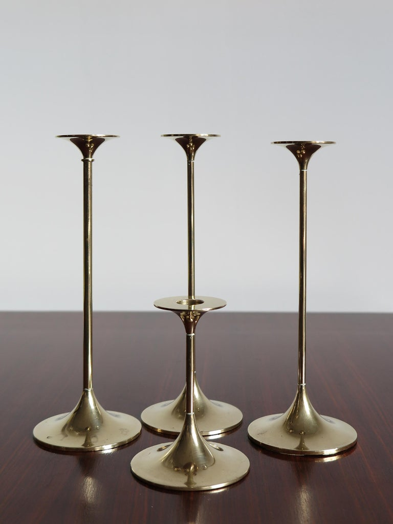 Set of four Mid-Century Modern design solid brass Scandinavian candleholders designed by Max Brüel for Torben Ørskov with engraved manufacturer logo, Denmark, circa 1950.  Please note that the items are original of the period and this shows normal