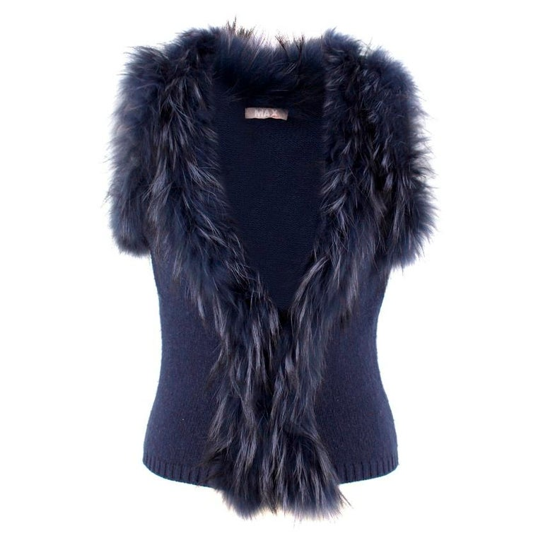 Max by Lederer Cashmere & Wool Gilet  - Sleeveless - Ribbed hemline - Racoon fur collar - 2 concealed navy hook and eye closures to fasten  Approx Measurements are taken laying flat, seam to seam.   Length: 53cm Waist: 36.5cm