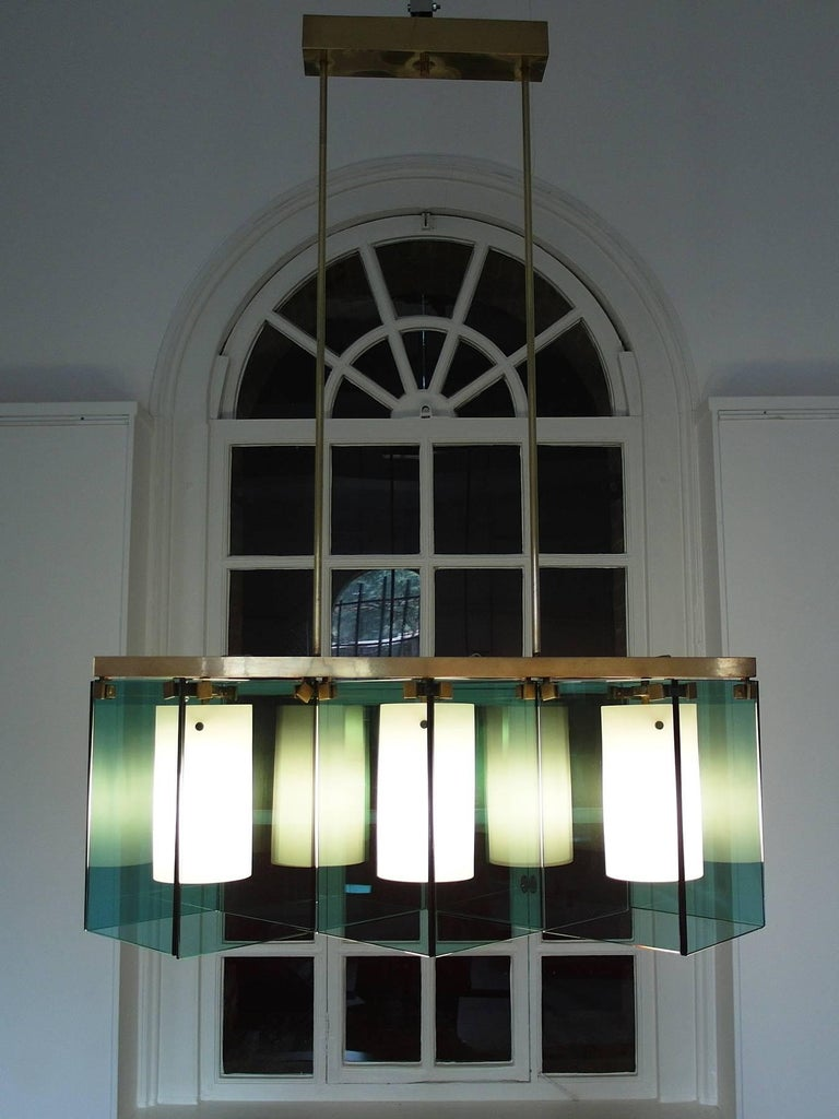 A rare chandelier designed by Max Ingrand for Fontana Arte, Italy, 1964. Fontana Arte model number 2128. This stunning chandelier is composed of two rectangular and eight square translucent green (verde nilo) crystal glass panels and three satin