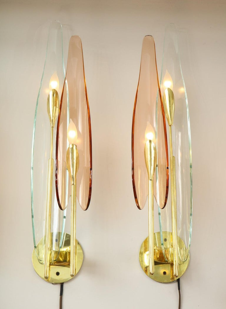 Brass structures with alternating clear and rose colored glass