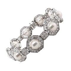 Art Deco Inspired Round Pearls Diamonds 6.35 Carat Platinum Bracelet