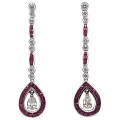 Pear Cut Diamond 1.5 Carat Rubies 2.90 Carat Dangling Platinum Earrings