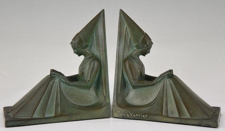 """Art Deco bookends modelled as a pair of seated medieval ladies while they are reading a book. The stylish sculptures have a lovely green patina and are signed by the famous sculptor Max Le Verrier, France, circa 1930.  """"Art Deco sculpture"""" by"""