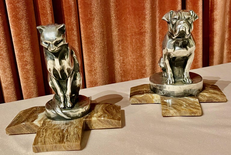 A pair of Art Deco figural bookends in the shape of a cat and bulldog by the French artist Max Le Verrier. These are silvered finish and arrived without the marble base. We were able to make this custom base fitting which helps to give these two