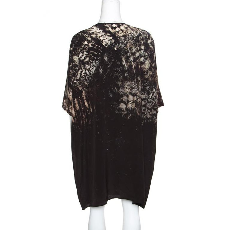 This Bianca dress from Max Mara is for those who like laid-back fashion on some days. It is made from silk and designed with short sleeves and a large print of an owl. You can team it with sneakers or slides.  Includes: The Luxury Closet
