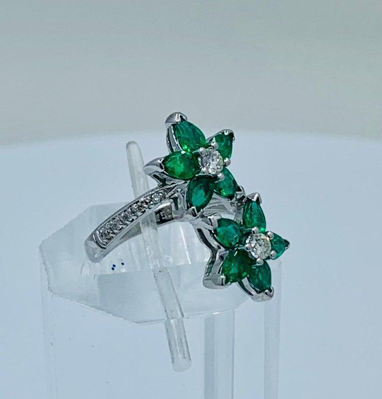 Women's Vivid Green Emerald and Diamond 18 Karat White Gold Double Flower Ring For Sale