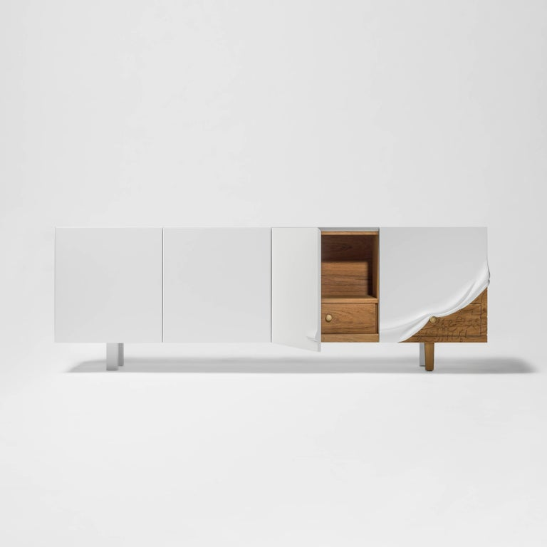 Talisman cabinet designed by Maysam Al Nasser manufactured by BD Design  Limited edition of eight units, two Artist proofsand two Prototypes.  Lacquered white matte MDF container with three drawers, all internally laminated in teak