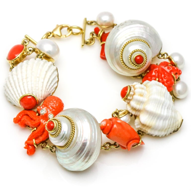 MAZ 18 Karat Yellow Gold Coral Shell Pearl Diamond Charm Bracelet In Fair Condition For Sale In Fort Lauderdale, FL