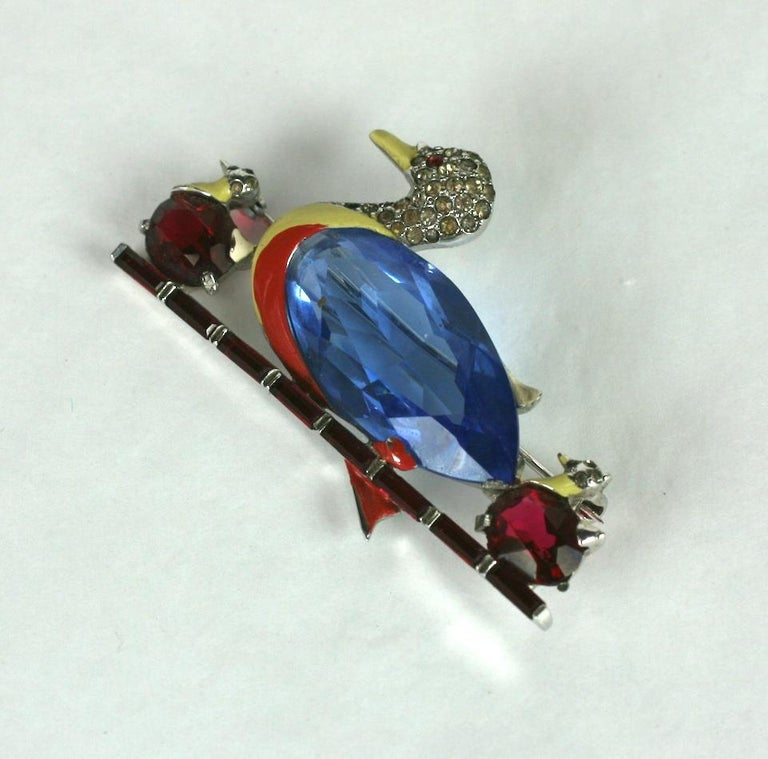 Collectible Mazer Art Deco Duck brooch with baby chicks. Wonderful design with cut stone bellies and enamel accents, floating on a line of faux ruby baguettes. 1930's USA.  2.25