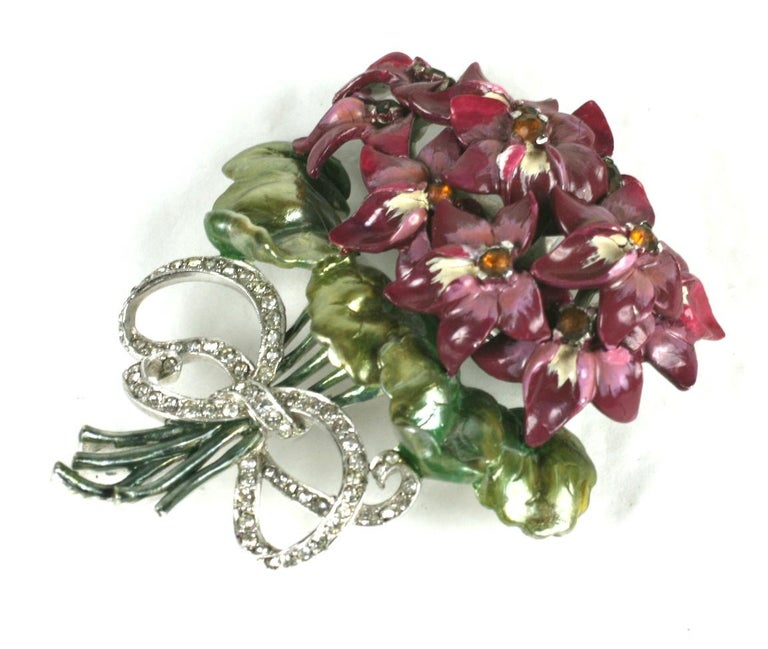 Large and wonderful Mazer violet bouquet brooch of pearlescent cold enamel. The finely detailed cold enamel is painted in shades of purple violets with ombre green leaves set with amber crystal rhinestones. The bouquet is tied with a crystal pave