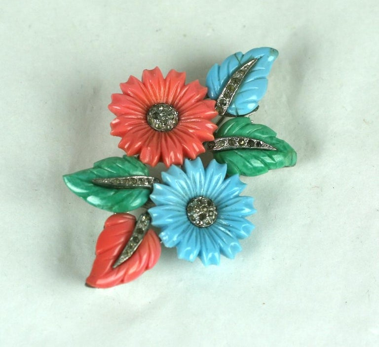 Art Deco Mazer tricolor fruit salad flower and leaf spray brooch of rhodium plated base metal, crystal rhinestones, faux coral, jade and turquoise pressed and hand finished glass fruit salad leaves and flower heads. Patents for the leaves and