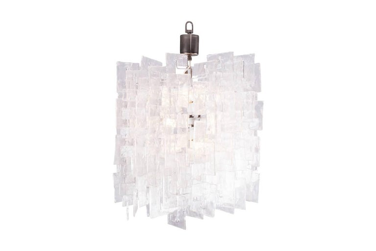Mid-Century Modern chandelier designed by Carlo Nason for Mazzega with interlocking opalescent glass pieces. This is one of the biggest of its kind at with 12 lighting points inside compared to mostly six and a diameter of 65 cm and height of 80