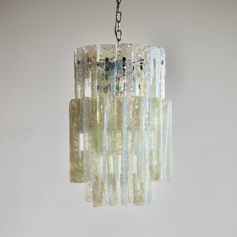 Glass Chandelier by Mazzega. Italy, Murano 1960s.  Vintage hanging lamp comprising of a metal frame and some 52 interlocking glass pieces, hand-made in Murano. Rare chandelier with interlocking opal glass pieces with a hint of green colour. Four