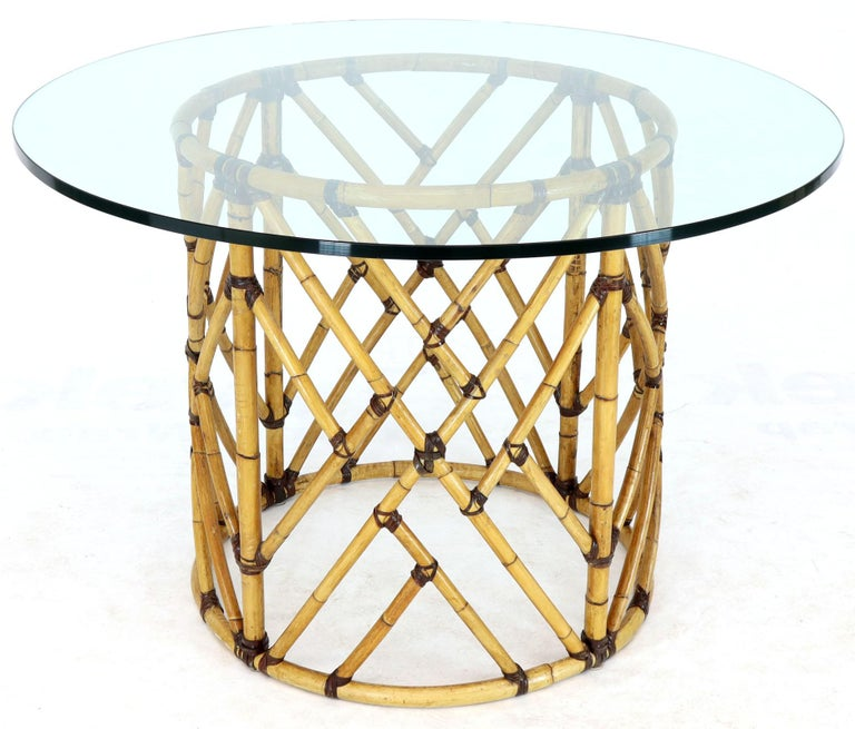 Mid-Century Modern round glass top dining table six chairs bamboo dining se by McGuire. Outstanding craftsmanship all bamboo parts are bonded with two different kinds of real leather. Pictured with 48