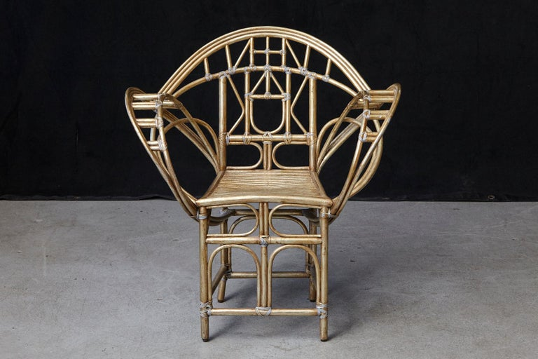Designed by Edward Tuttle, McGuire's famous Butterfly chair is a study in fluidity. This graceful design features sweeping arms of delicate rattan. The arching back displays a symmetric series of both curved and geometric rattan members. Likewise,
