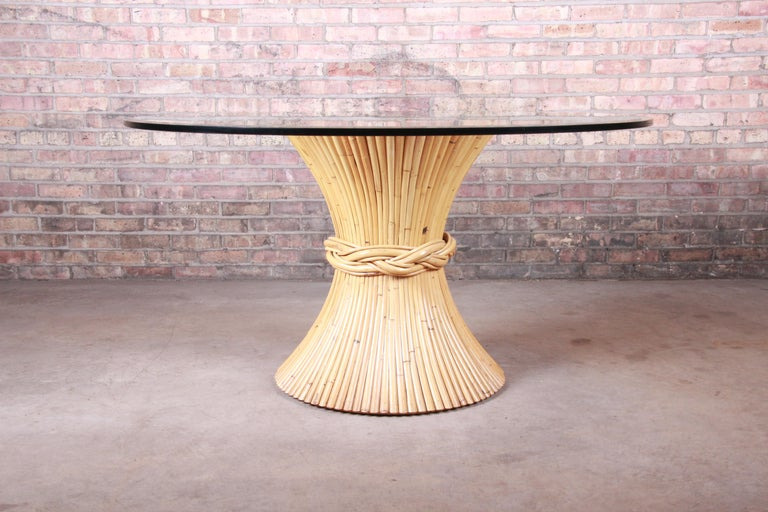 A gorgeous Mid-Century Modern Hollywood Regency bamboo sheaf of wheat pedestal dining table