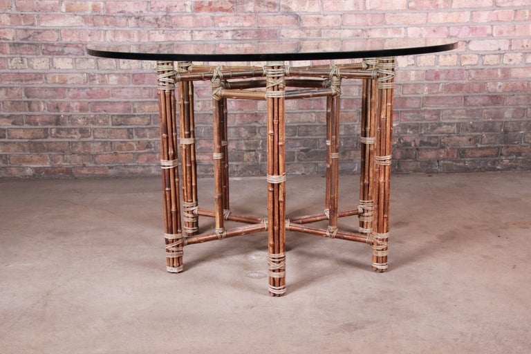Mid-Century Modern McGuire Organic Modern Bamboo, Rattan, and Leather Glass Top Dining Table For Sale