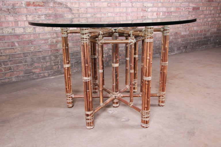McGuire Organic Modern Bamboo, Rattan, and Leather Glass Top Dining Table In Good Condition For Sale In South Bend, IN