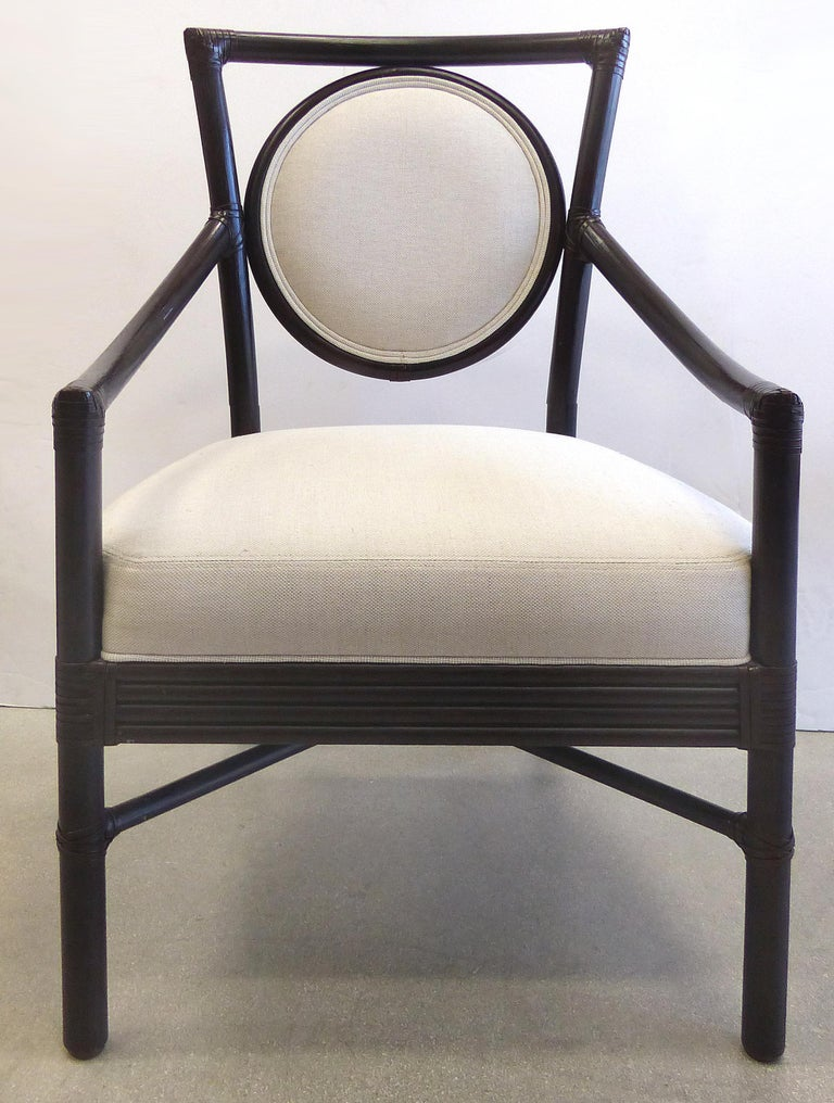 McGuire Rattan Dining Chairs with Leather Bindings in Linen Upholstery, Set of 6  Offered for sale is a set of six rattan dining armchairs by McGuire furniture of San Francisco. All of the chairs are finished in an espresso color and have the