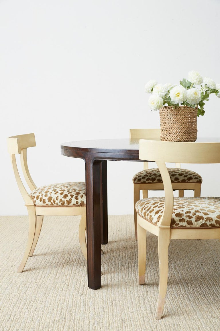 Gorgeous genuine McGuire round oak dining or centre table. Features a cerused oak finish in a rich, dark stain. The table has a subtle Asian Ming style design with graceful curves. The rich grain patterns are cerused and have an ebonized look.