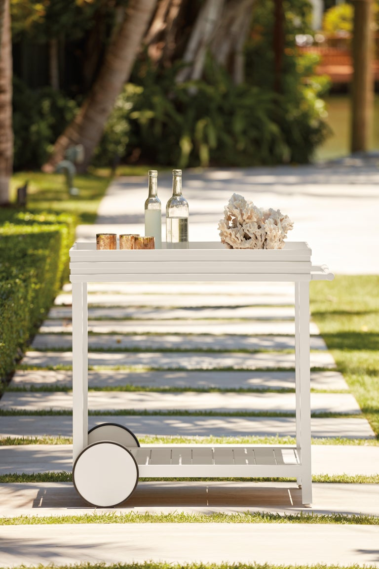 McKinnon and Harris Perrow Drinks Cart in York River Oyster finish. High performance outdoor aluminum furniture for estate, garden, and yacht. Our chic drinks trolley is highlighted by sleek Perrow raised banding, a signature detail crafted from