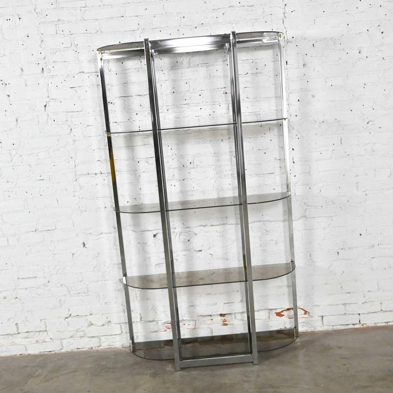 Gorgeous Mid-Century Modern étagère comprised of a bow shape chrome frame and 5 bowed smoked glass shelves. Done in the style of James David or Design Institute of America aka DIA. Beautiful condition, keeping in mind that this is vintage and not