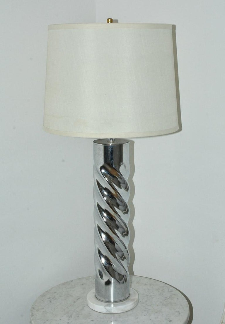Highly stylish contemporary chrome table lamp with marble base. Elegance and style, the lamp lends itself to be used in many decor.  Height with shade - 32.63
