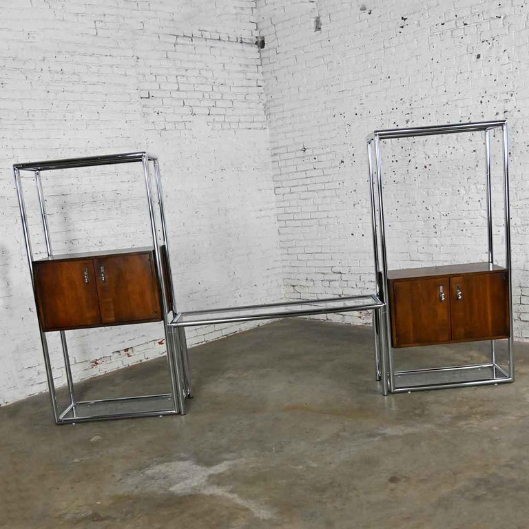 Gorgeous MCM (a.k.a. mid-century modern) chrome and walnut veneer entertainment display cabinet or room divider 3-piece unit by Lane Furniture Style #1480 69. Comprised of two tall, chromed metal tube frame units with walnut veneer cabinets, upper