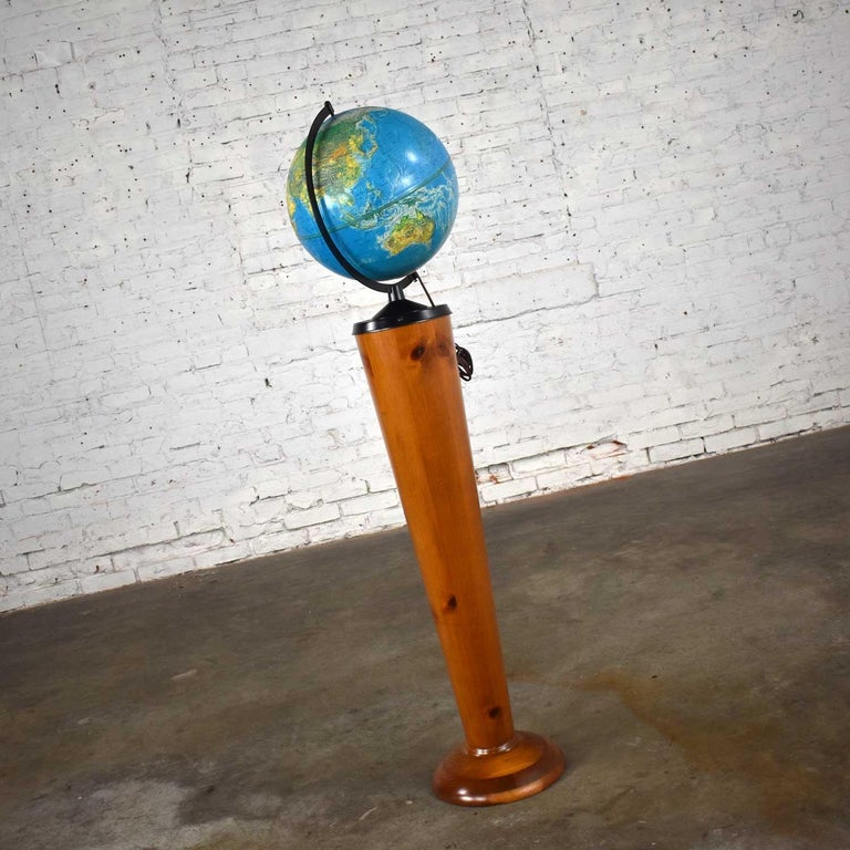 """Wonderful Repogle World Horizon Series lighted 12"""" diameter plastic world globe, metal axle, and a custom pine Stand. Beautiful condition with wear as you would expect with a vintage piece. Please see photos, Circa 1950-1980.     See the world"""