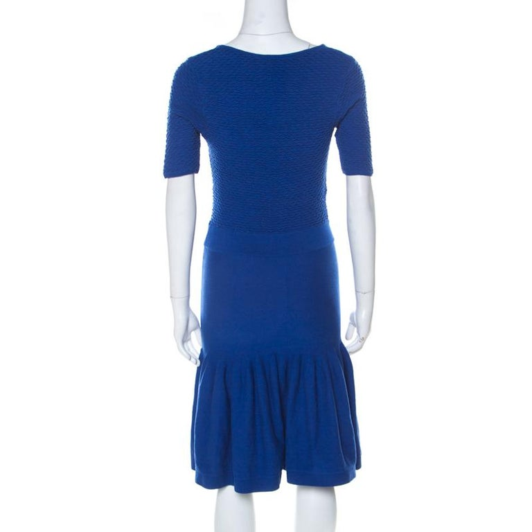 The tailoring of the attire is definite and exquisite making it another perfect creation of McQ by Alexander McQueen. Offering style and grace, this blue dress is nothing but pure elegance. Designed with short sleeves and a cutout detail, this dress