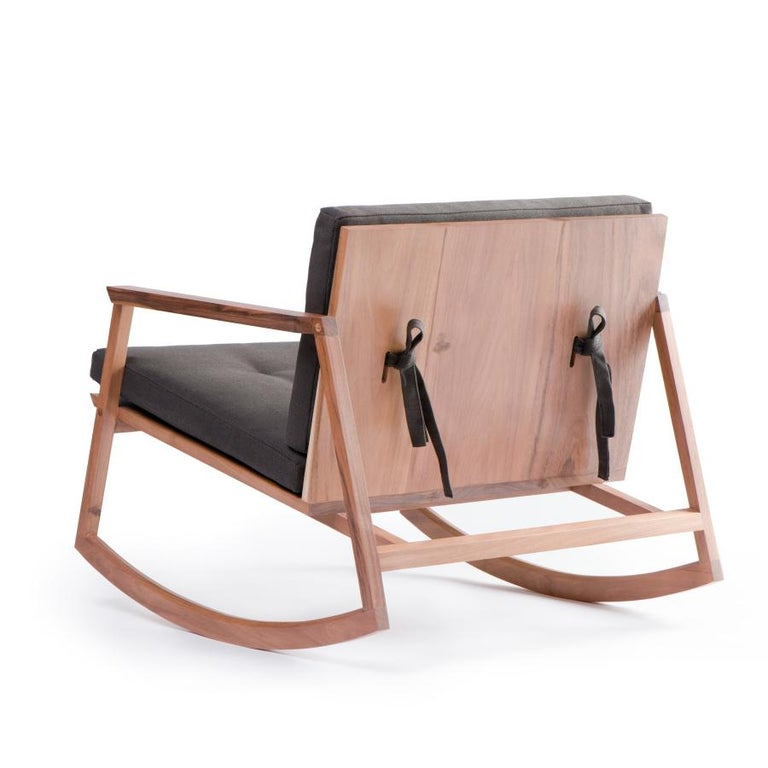 """The rocking chair is the evolution of the lounge chair """"Tumbona Dedo"""". It maintains the Tumbona Dedo's geometry, balancing it with its bottom curve to provide comfort. Produced in two different types of wood: tzalam and oak. One of the main"""