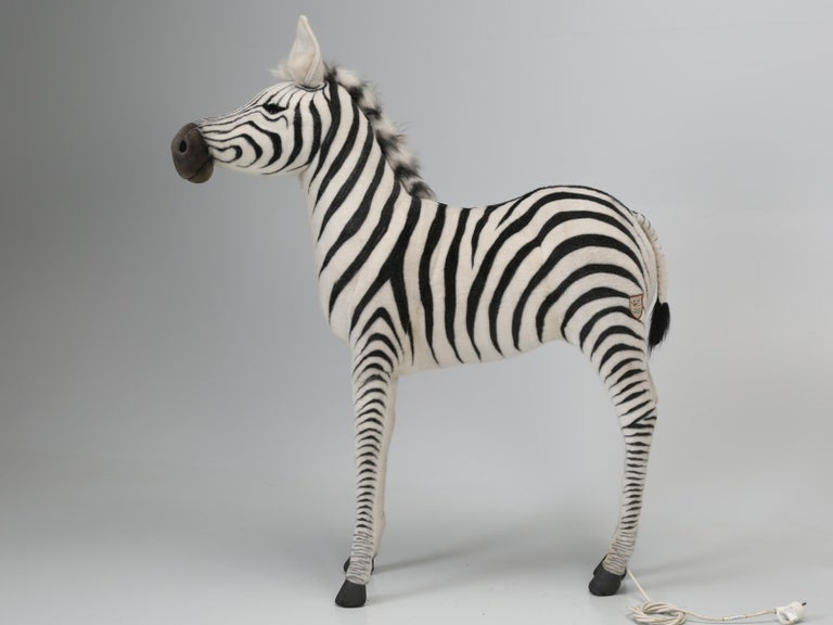 The famous stuffed animal company, Hansa, was created in 1972 by German-born Hans Axthelm. Each and every Hansa stuffed animal, is hand sewn, using the inside-out method, in order to avoid visible seams. This particular animated or mechanical Zebra