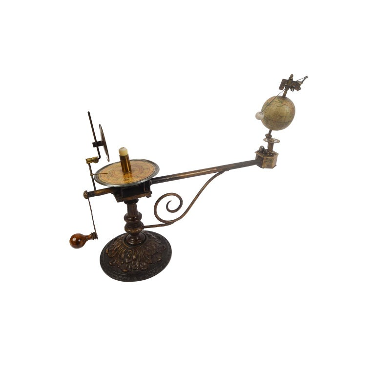 Rare orrery, or mechanical model depicting the solar system, from the second half of the 19th century. On the cartouche of the globe we read: Globus Jan Felkla Syn Roztoky Prahy. Bronze patinated cast iron structure, brass gears and terrestrial