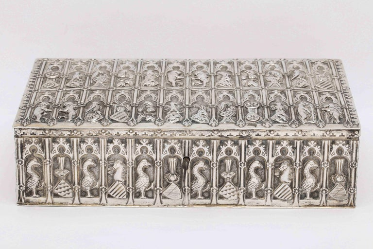Medieval style, continental silver jewelry box, Germany, circa 1900. Decorated with Medieval figures and designs. Measures: 9 1/4 inches wide x almost 2 1/2 inches high x 5 1/4 inches deep. Lined in purple velvet. The top purple velvet tray, which