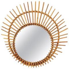Mediterranean Rattan Wicker Asymmetric Ovoid Sunburst Mirror, France, 1960s