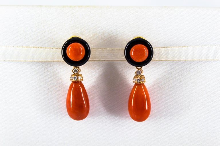 These Clip-On Earrings are made of 14K Yellow Gold with 18K Yellow Gold Clips. These Earrings have 0.18 Carats of White Diamonds. These Earrings have Red Mediterranean (Sardinia, Italy) Coral. These Earrings have also Onyx. All our Earrings have