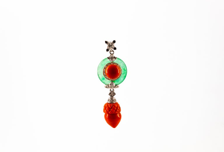 This Necklace is made of 14K White Gold. This Necklace has 0.38 Carats of White Diamonds. This Necklace has 0.04 Carats of Black Diamonds. This Necklace has also Jade and Mediterranean (Sardinia, Italy) Red Coral. Necklace Length is 42cm. We're a
