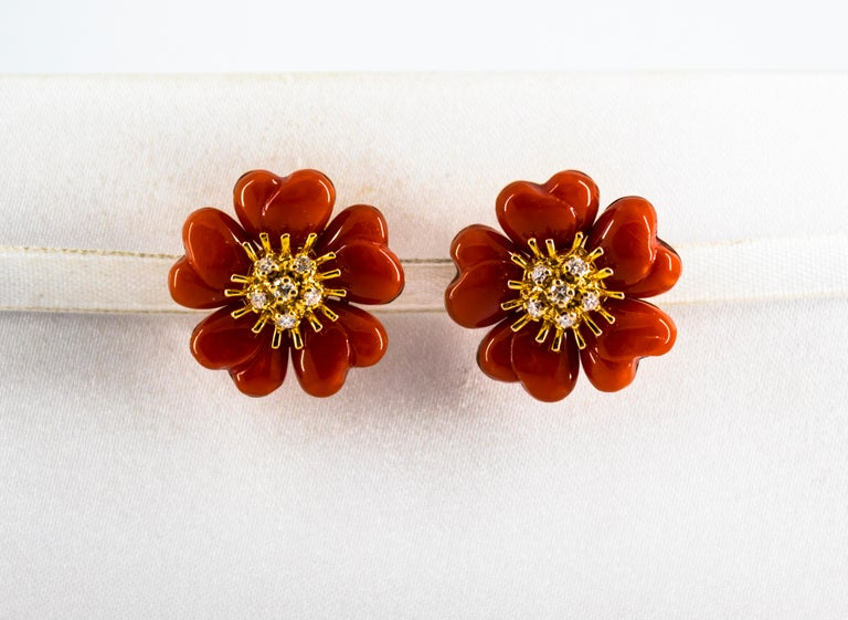 These Earrings are made of 14K Yellow Gold. These Earrings have 0.45 Carats of White Diamonds. These Earrings have Mediterranean (Sardinia, Italy) Red Coral. These Earrings are available also in White Coral, Pink Coral, Turquoise or Lapis