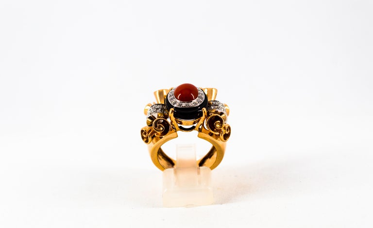 This Ring is made of 14K Yellow Gold. This Ring has 0.47 Carats of White Diamonds. This Ring has Red Mediterranean (Sardinia, Italy) Coral. This Ring has also Onyx. Size ITA: 14 USA: 6 3/4 This Ring is available also with a central Turquoise. We're