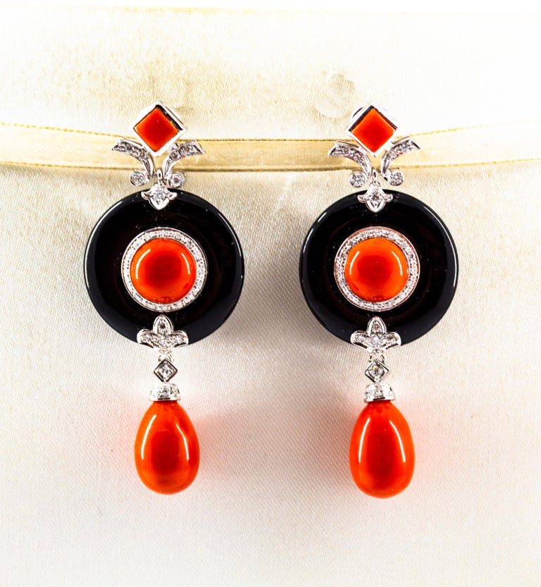 These Clip-On Earrings are made of 14K White Gold with 18K White Gold Clips. These Earrings have 0.70 Carats of White Diamonds. These Earrings have Red Mediterranean (Sardinia, Italy) Coral. These Earrings have also Onyx. All our Earrings have pins