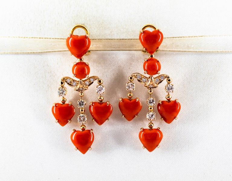 These Clip-On Earrings are made of 14K Yellow Gold. These Earrings have 0.90 Carats of White Diamonds. These Earrings have Red Mediterranean (Sardinia, Italy) Coral. All our Earrings have pins for pierced ears but we can change the closure and make