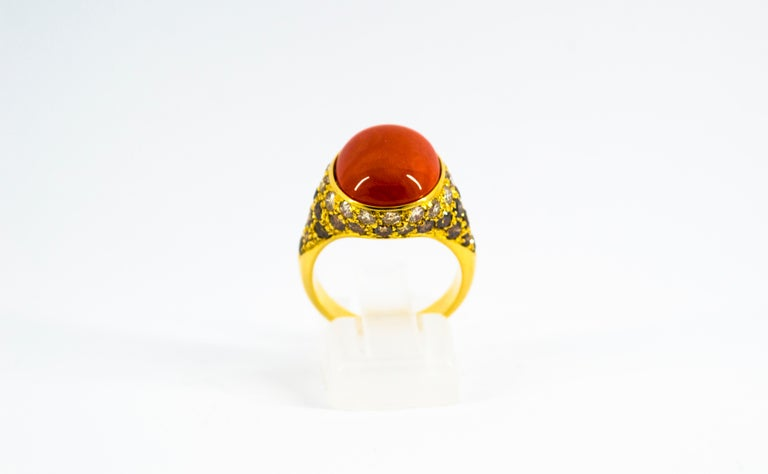 This Ring is made of 18K Yellow Gold. This Ring has 0.80 Carats of White Diamonds. This Ring has 1.40 Carats of Brown Diamonds. This Ring has a Mediterranean Cabochon (Sardinia, Italy) Red Coral. Size ITA: 13 USA: 6 1/2 We're a workshop so every