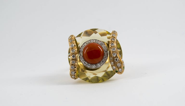 This Ring is made of 14K Yellow Gold. This Ring has 0.60 Carats of White Diamonds. This Ring has a 9.00 Carats Citrine. This Ring has 0.02 Carats of Tsavorite. This Ring has a Red Mediterranean (Sardinia, Italy) Coral and a Citrine. This Ring is