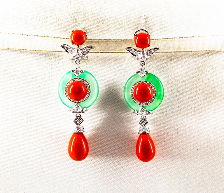 These Clip-On Earrings are made of 14K White Gold. These Earrings have 0.65 Carats of White Diamonds. These Earrings have also Mediterranean (Sardinia, Italy) Red Coral and Jade. All our Earrings have pins for pierced ears but we can change the