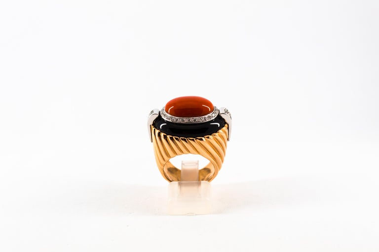 This Ring is made of 14K Yellow Gold. This Ring has 0.40 Carats of White Diamonds. This Ring has Red Mediterranean (Sardinia, Italy) Coral. This Ring has also Onyx. Size ITA: 14 USA: 7 This Ring is available also with a central Turquoise. We're a