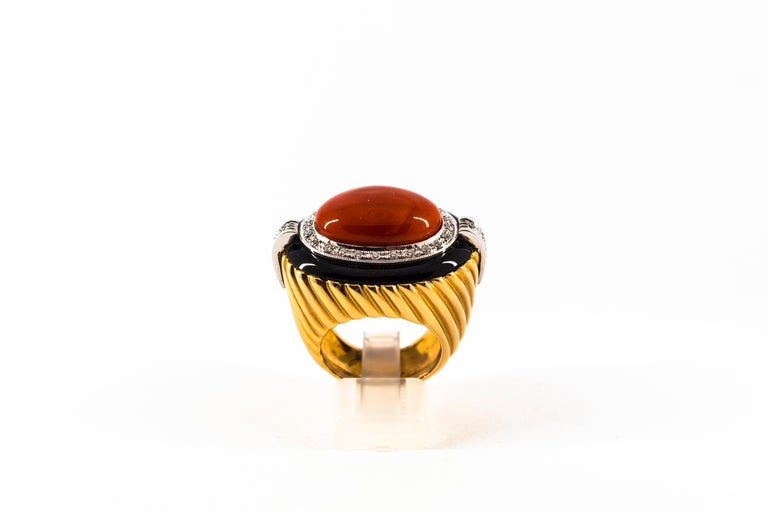 This Ring is made of 14K Yellow Gold. This Ring has 0.50 Carats of White Diamonds. This Ring has Red Mediterranean (Sardinia, Italy) Coral. This Ring has also Onyx. Size ITA: 17 USA: 8 This Ring is available also with a central Turquoise. We're a